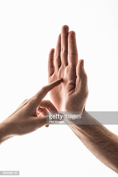 Finger touching palm