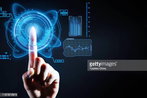 finger touching the futuristic transparent screen - hud interfaccia grafica utente foto e immagini stock