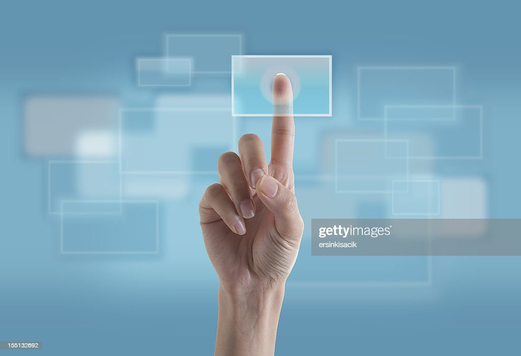 finger touching transparent digital touch screen stock photo getty