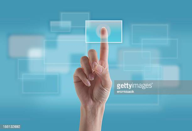 finger touching transparent digital touch screen - biometrics stock photos and pictures