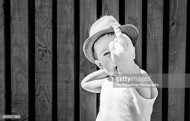 finger up - kid middle finger stock pictures, royalty-free photos & images