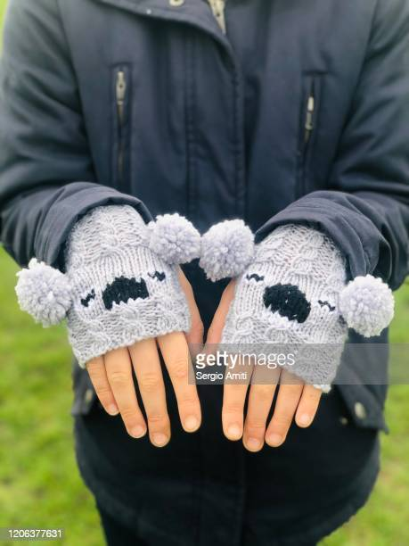 fingerless mittens with koala shape - fingerless gloves stock pictures, royalty-free photos & images