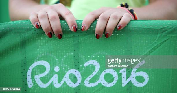Fingernails painted in the German national colors of rider Julia Krajewski of Germany pictured in the Olympic Equestrian Centre in Deodoro Rio de...
