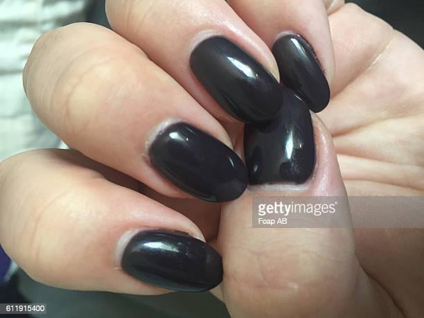 Fingernails with black nail polish