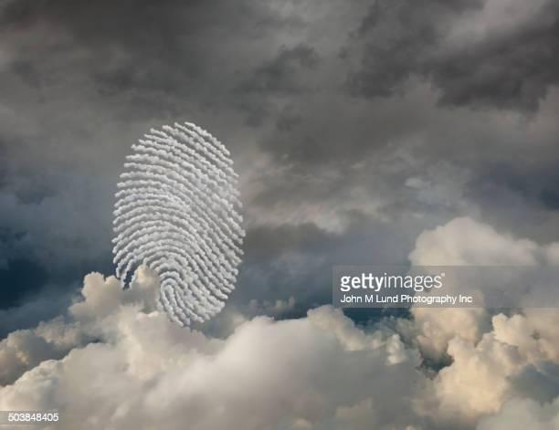 Fingerprint in cloudy sky
