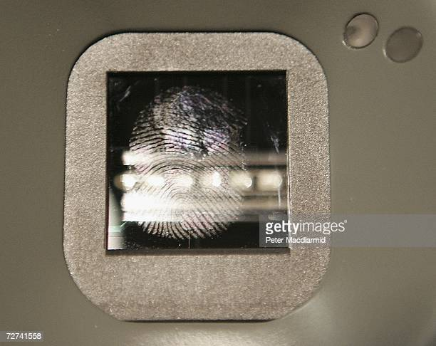 A fingerprint mark is left on a new biometric check in kiosk at terminal three on December 6 2006 at London's Heathrow airport The new check in kiosk...