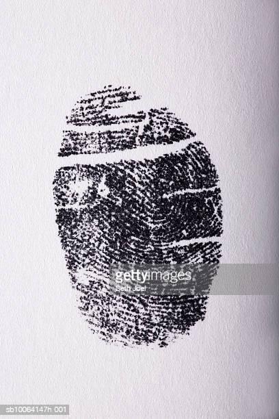 Fingerprint on white paper