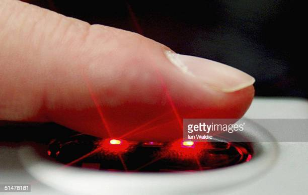 A fingerprint scanner is demonstrated during the Biometrics 2004 exhibition and conference October 14 2004 in London The conference will examine the...