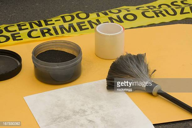 Fingerprinting at a crime scene.
