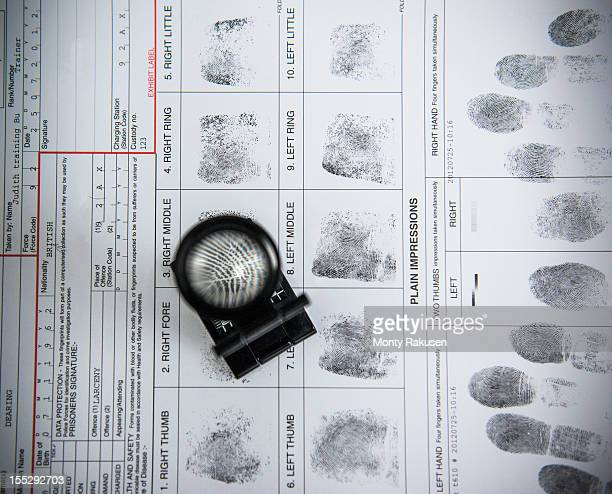 fingerprints with loupe on arrest form in forensic laboratory - 法科学 ストックフォトと画像