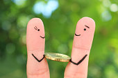 Fingers art of happy people. Concept of man giving a bribe.