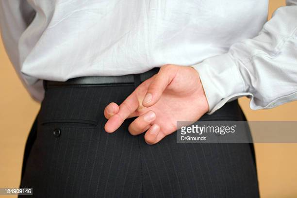 fingers crossed - con man stock photos and pictures