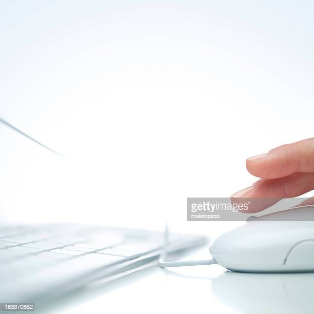 Fingers hovering over computer mouse