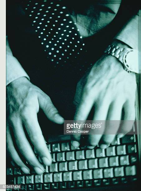 fingers of a man typing on a lap-top - human joint stock pictures, royalty-free photos & images