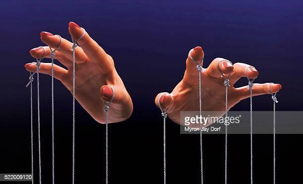 fingers of a puppeteer - persuasão - fotografias e filmes do acervo