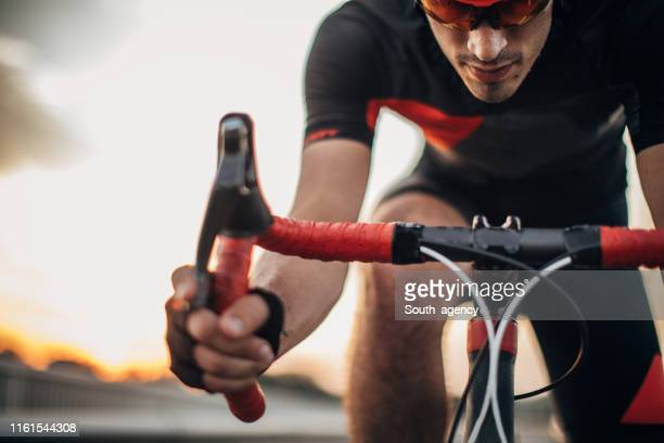 fingers on brakes - professional sportsperson stock pictures, royalty-free photos & images