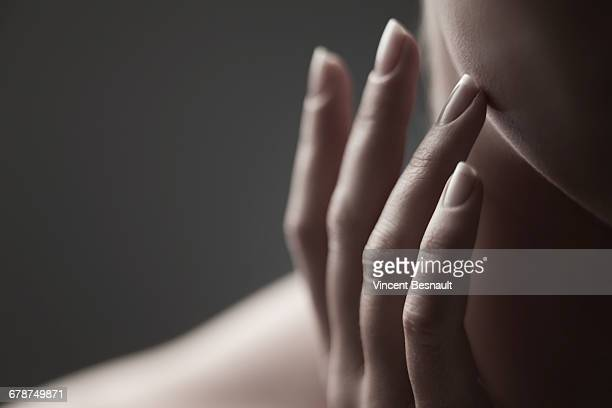 fingers on the cheek of a woman - cheek stock pictures, royalty-free photos & images