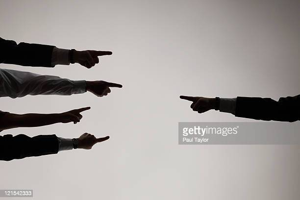fingers pointing each other - blame stock pictures, royalty-free photos & images