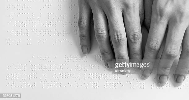 Fingers Reading Braille