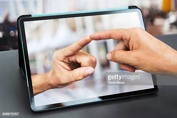 fingers touching  over a tablet computer. - touchpad stock pictures, royalty-free photos & images