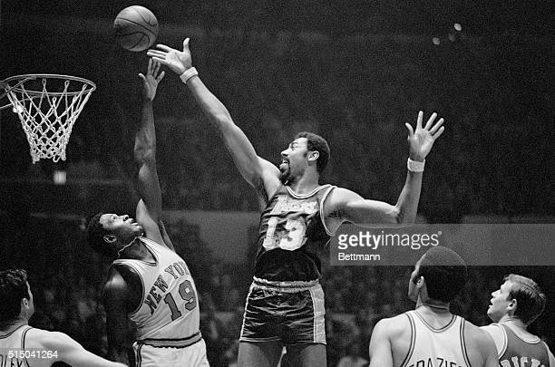 Wilt Chamberlain of the Los Angeles Lakers and Willis Reed of the New York Knickerbockers go after a rebound during game at Madison Square Garden...