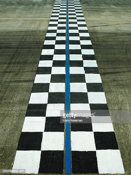 Finish line on auto race track, dusk