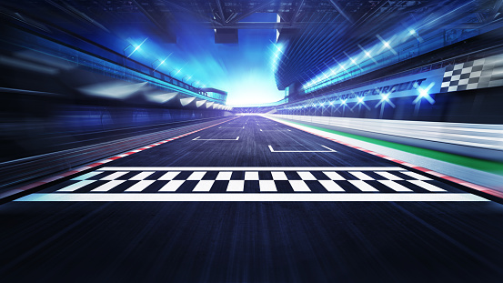 finish line on the racetrack with spotlights in motion blur 1056229106