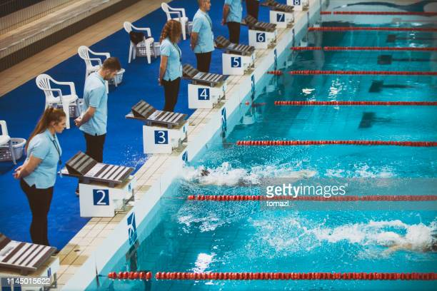 finish of the swimming competition - championships stock pictures, royalty-free photos & images