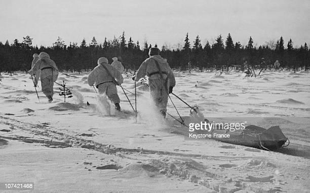 Finish Soldiers Hauling A Machine Gun On A Toboggan In Soviet Finnish War On March 1940