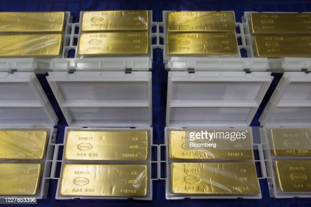 Finished 12.5 kilogram gold ingots sit on display at the Uralelectromed Copper Refinery, operated by Ural Mining and Metallurgical Co. , in...