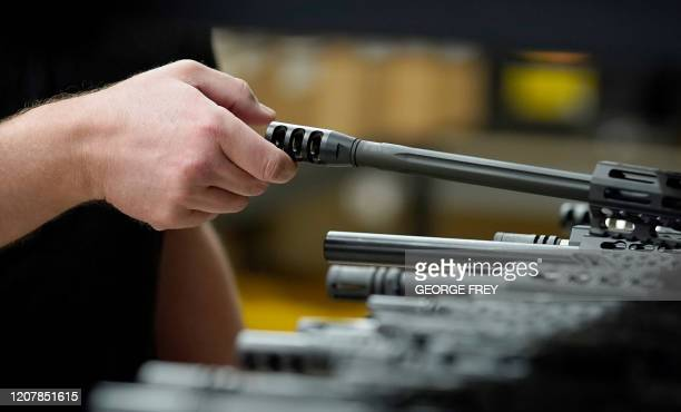 Finished AR15 rifle barrels are stacked on shelves at Delta Team Tactical in Orem Utah on March 20 2020 Gun stores in the US are reporting a surge in...