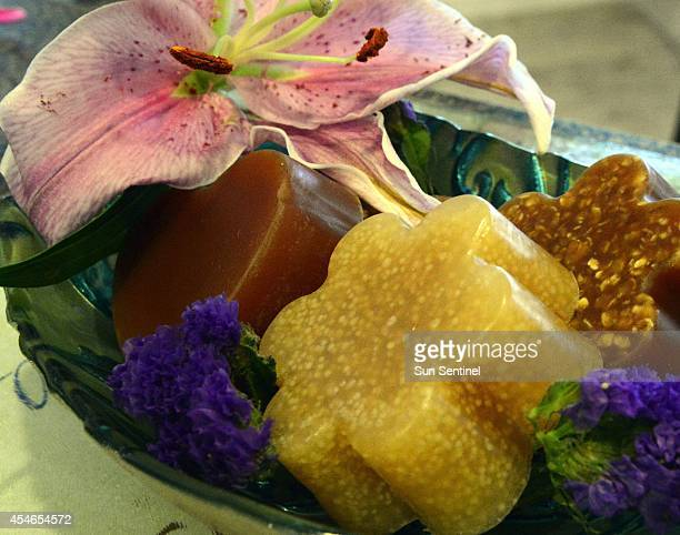 Finished breast milk soap made by Paula D'Amore of Greenacres Fla rests in a dish Aug 29 2014 The statyathome mom started Liquid Gold Soaps to make...