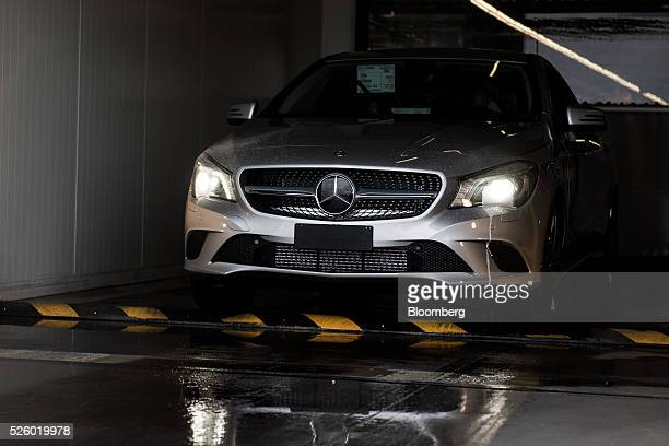 Finished CLA-class automobile drives out to the delivery area at the Mercedes-Benz AG automobile plant, operated by Daimler AG, in Kecskemet,...