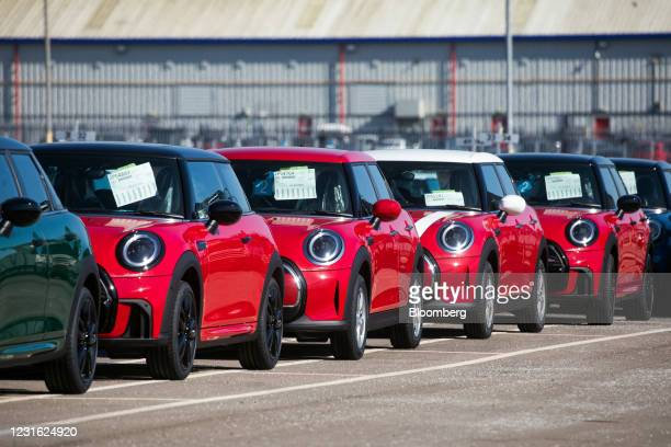 Finished Mini automobiles parked at Bayerische Motoren Werke AG's Mini final assembly plant in Cowley near Oxford, U.K., on Tuesday, March 9, 2021....