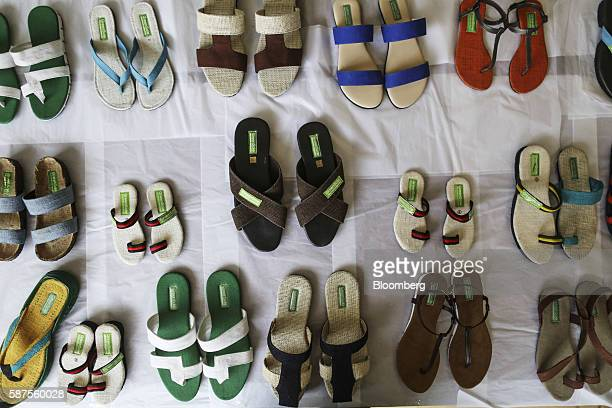 Finished pairs of shoes sit at the Greensole sample workshop in Mumbai India on Monday Aug 8 2016 India's crowdfunding companies are using the power...