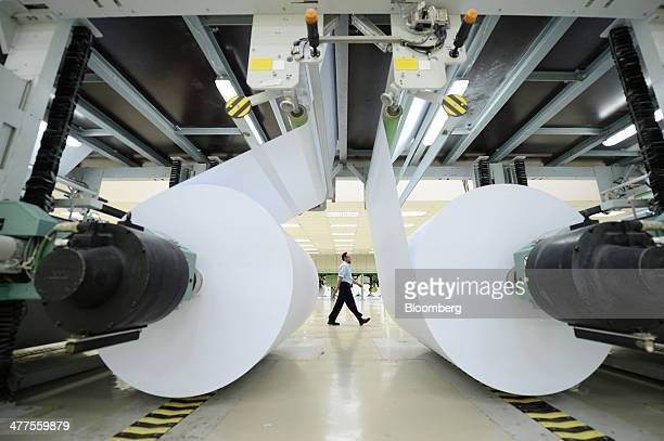 Finished paper is wound onto spools at Asia Pacific Resources International Holdings Ltd's pulp and paper manufacturing facility in Pelalawan Riau...