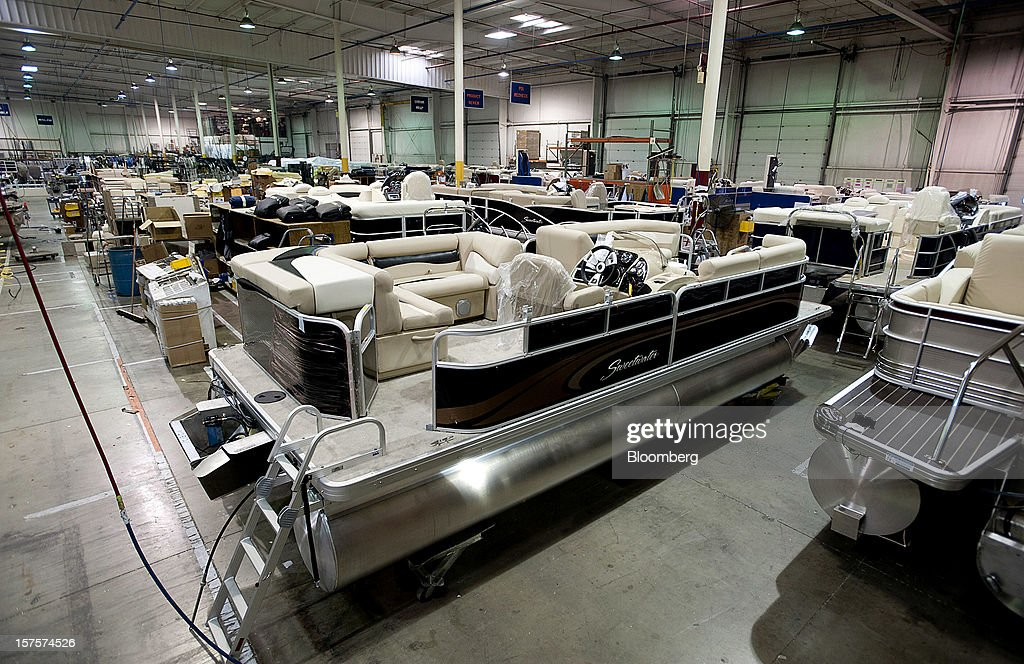 Finished pontoon boats sit in the warehouse waiting to shipped at the Nautic Global Group production facility in Elkhart, Indiana, U.S., on Tuesday, Dec 4, 2012. The U.S. Census Bureau is scheduled to release factory orders data on Dec. 5. Photographer: Ty Wright/Bloomberg via Getty Images