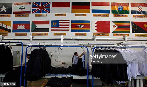 Finished shirts and jackets hang on racks as they await ironing in the garment area at a PT Sri Rejeki Isman factory in Sukoharjo Java Indonesia on...