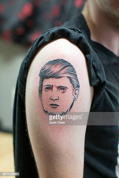 A finished tattoo portriat of Republican presidential candidate Donald Trump on the arm of Seth Bailey at the Clay Dragon Tattoo shop on January 29...