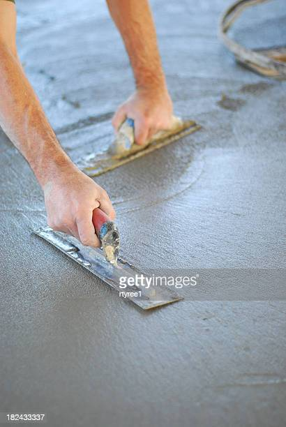 finishing concrete - spreading stock pictures, royalty-free photos & images