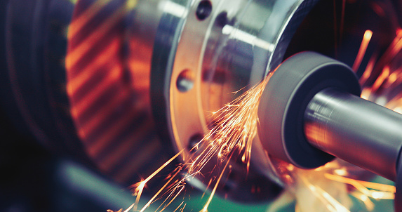 Finishing metal working on high precision grinding machine in workshop 896359458