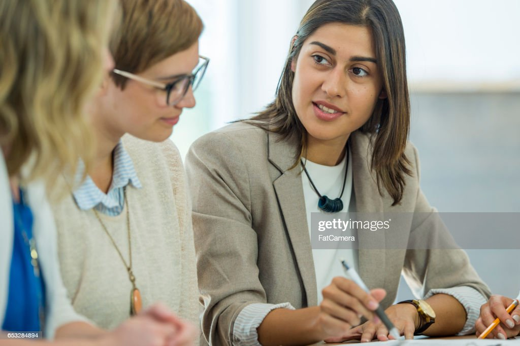 Finishing Paperwork in the Boardroom : Stock Photo