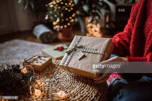 finishing up her christmas presents - christmas trees stock pictures, royalty-free photos & images