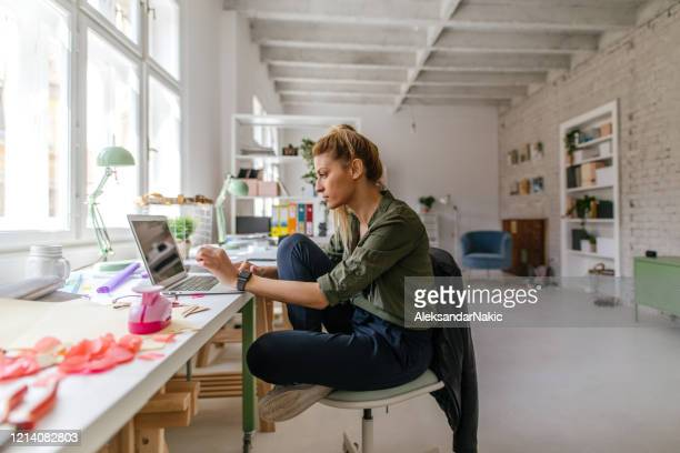 finishing work online from home office - remote location stock pictures, royalty-free photos & images