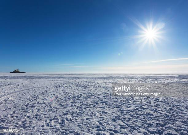 Finland blue sky and iced sea with Arctic icebreaker ships, North Pole