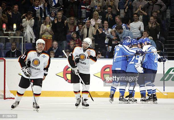Finland celebrates their first goal against Germany in the second period during the Quarterfinals of the World Cup of Hockey September 6, 2004 at...
