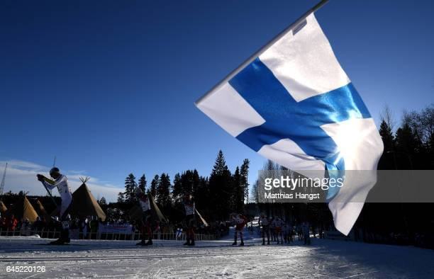 Finland flag is waved as the skiers compete in the Men's Cross Country Skiathlon during the FIS Nordic World Ski Championships on February 25 2017 in...