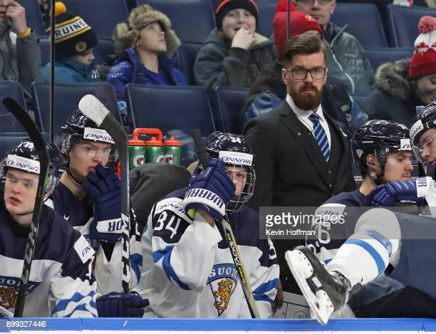 Finland head coach Jussi Ahokas watches play against Denmark in the second period during the IIHF World Junior Championship at KeyBank Center on...