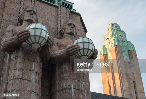 Finland, Helsinki, part of facade of Central railway station with statues