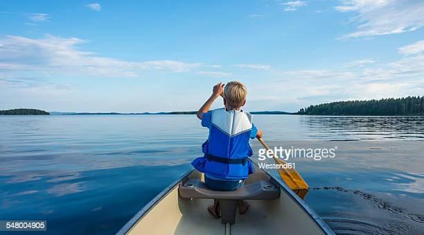 Finland, Karelia, canoeing boy on lake Pielinen